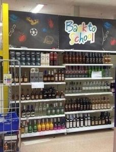 #tescofail back to school sign over alcohol