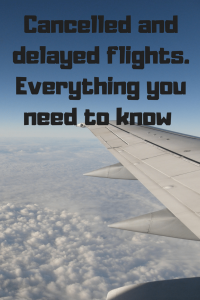 aeroplane wing above clouds in blue sky Cancelled and delayed flight everything you need to know
