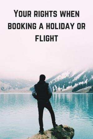 Man standing on rock looking out to water your rights when booking a holidays or flights
