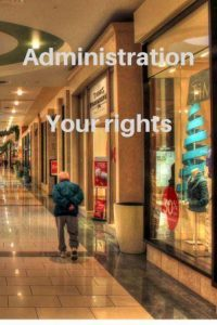 row of shops in shopping mall person walking along Administration your rights
