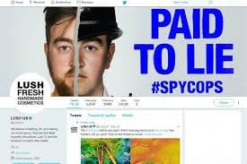 "Lush poster as Twitter feed header ""Paid to lie #spycops"" picture of man's face split in two police helmet one side"