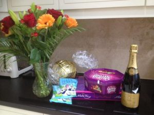Flowers chocolates sweets champagne