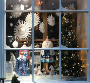 Christmas scene behind window children's clothes