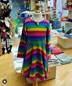 multi coloured dress in a shop on a mannequin